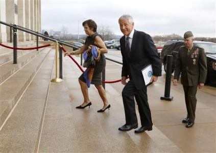 Former U.S. Senator Hagel smiles as he and his wife Lilibet arrive for his swearing-in and his first day as Secretary of Defense at the Pentagon in Arlington