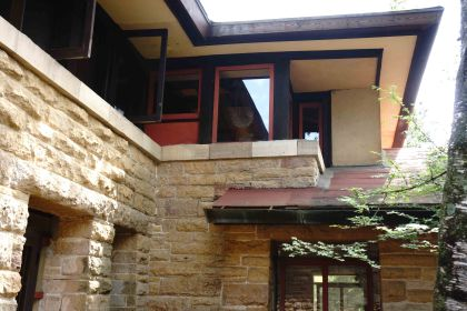 Wright was a pioneer in using windows almost like walls, to bring the outside in